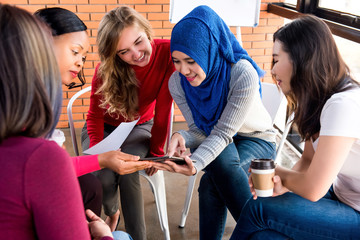 Group of casual multiethnic women meeting for social project