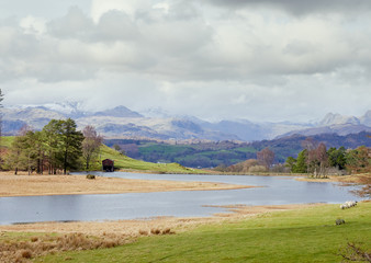 Views across Moss Eccles Tarn towards Scafell Pike in the English Lake District, UK.