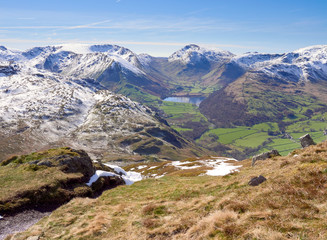 Snow covered mountains of Stony Cove, Red Screes and Brothers Water lake from Place Fell in the Lake District, England, UK.
