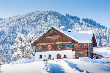Traditional farmhouse in winter wonderland in the Alps