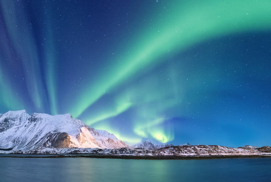 Northen light under mountains. Beautiful natural landscape in the Norway