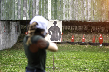 Target practice shooting in aim of woman shooting riffle,  arm and weapon martial art for woman