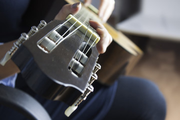 Woman playing a classic guitar