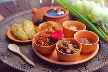 side dish of Kao Chae set in pottery, Thai traditional food usually eat in summer or songkran festival.