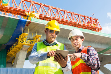 Architect and Engineer working Together with Digital Wireless Tablet