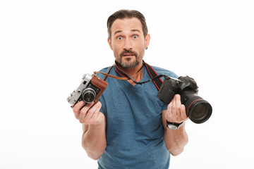 Shocked mature man photographer