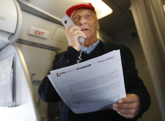 Lauda addresses the media aboard a Laudamotion plane in Duesseldorf
