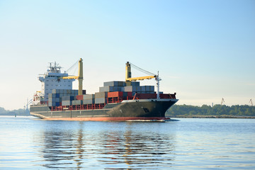 cargo container ship leaving port of Riga
