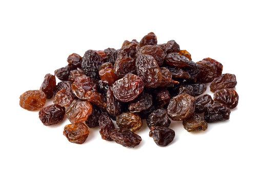 Dried raisins on white background.