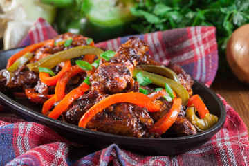 Chinese chicken wings with vegetables in sweet and sour sauce