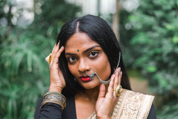 Indian Ethnic woman in traditional clothes at palm