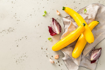 Yellow zucchini (courgettes), red onion and garlic - kitchen