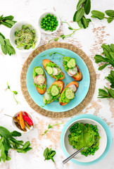 Refreshing crusty canapes with green peas and mint pesto