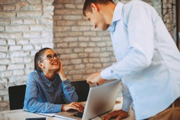 Man and woman flirting at work