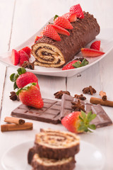 Chocolate roll with strawberries.