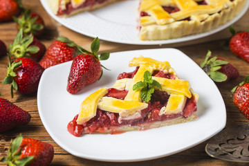 The strawberry pie in the wooden background