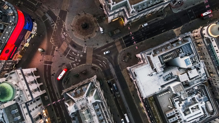 Bird's Eye View Flying Over Piccadilly Circus and Aerial View of London City Streets at Night in London England 4K