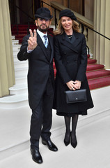 Ringo Starr, who's real name is Richard Starkey, arrives with his wife Barbara Bach to receive his Knighthood at an Investiture ceremony at Buckingham palace in London
