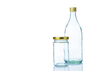 Empty clear glass bottles in various sizes and shapes with lids on white background