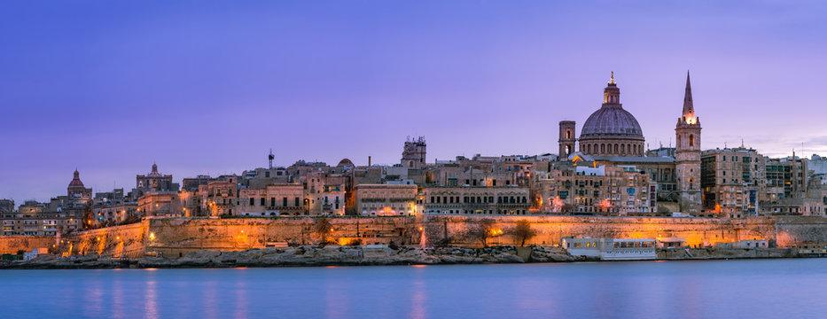 Panoramic skyline of illuminated Valletta in Malta