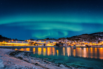 Northern lights, Aurora borealis in night sky over Gausvik, Lofoten Islands, Norway. Scenic winter landscape