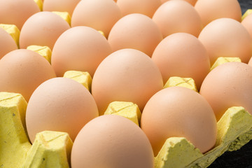 fresh eggs in a paper package close up