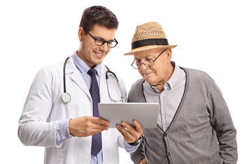 Doctor showing something on a tablet to a mature man