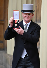 Author Sir Michael Morpurgo poses after he was awarded a Knighthood during an Investiture ceremony at Buckingham Palace, London