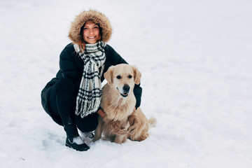 Picture of smiling girl with dog in winter park