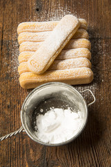 sponge biscuit - ladyfinger savoiardi on a wooden table