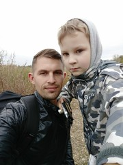 Selfie father and son in the Park for a walk,