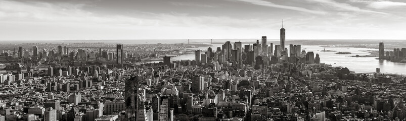 Wall Mural - Aerial panoramic view of Lower Manhattan in Black and White. The view includes Financial District skyscrapers, East and West Village, the Hudson River, New York Harbor, and Brooklyn, New York City