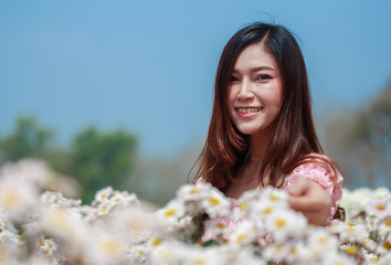 beautiful woman in chrysanthemum glower garden