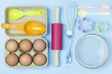 Baking utensils tool pastel style on blue background topview flatlay.