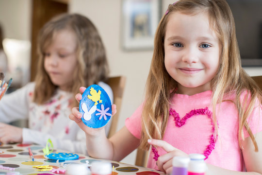Two Girls Making Easter Decorations At Home