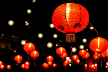 a spattering of red Chinese paper lanterns all lit up for Chinese New Year