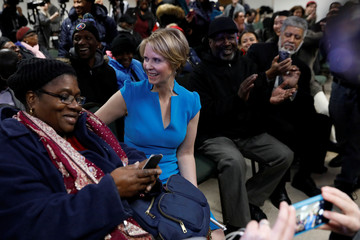 Actress Cynthia Nixon sits with people at campaign stop after announcing that she is running for Governor of New York in Brooklyn