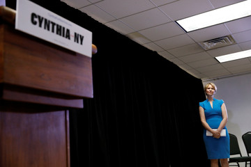 Actress Cynthia Nixon stands before her announcement that she is running for Governor of New York in Brooklyn