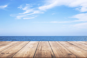 Wooden table with seascape background