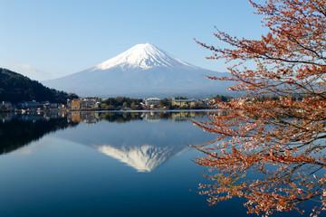Mount Fuji with Blooming Sakura and Reflection on Kawaguchiko lake in Japan