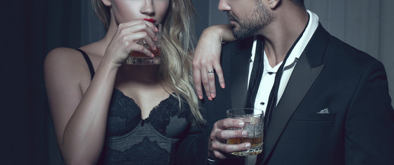 Rich man with lover with drink in night club Fototapete