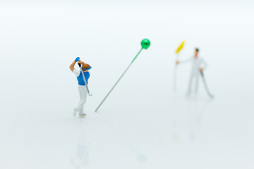 Miniature people : Businessmen spend their free time for Golf activities. Image use for sport, hobbies concept.