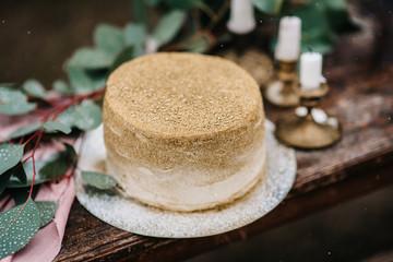 wedding decor with a golden cake