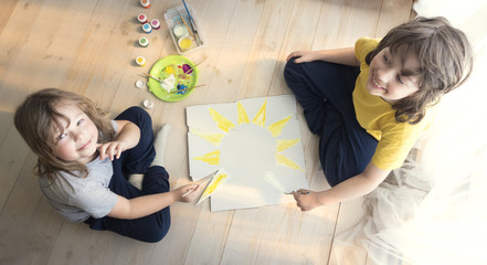 Children draw sun in home, Boy studying drawing at school