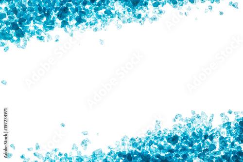 crystals of blue sea salt border on white background stock photo