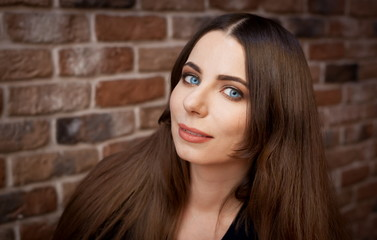 Face, blue eyes,  smile, brick wall background