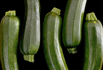 Zucchini (zucchetti, courgettes) on a black background