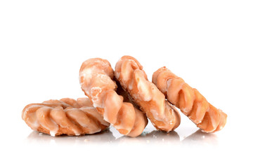Four cruller donuts in pile isolated white background