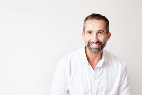 handsome bearded man in white shirt