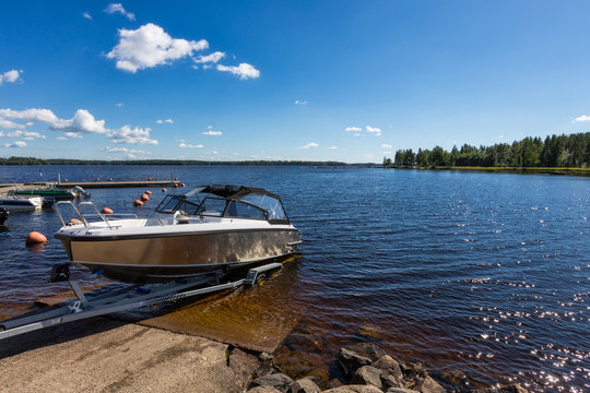 Boat launch on lake water from trailer